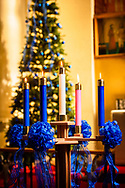 Advent candles and Christmas tree background
